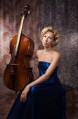Attractive woman in evening dress with old cello — Stock Photo