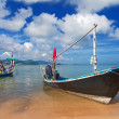 Long thai boat on sand beach - Stock Photo