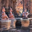 Ancient statues in the temple Banteay Srei - Stock Photo