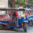Line of tuktuks with driver on Bangkok street — Stock Photo
