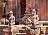 Ancient statues near the door — Foto Stock