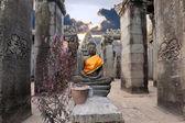 Buddha sitting in ancient temple Prasat Bayon — Stock Photo