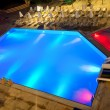 Stock Photo: Illuminated swimming pool at night