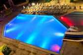 Illuminated swimming pool at night — Stock Photo