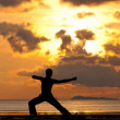 Man silhouette doing yoga exercise archer — Stock Photo