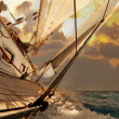 Sailboat crop during the regatta - Stock Photo