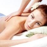 Young woman enjoyng a massage — Stock Photo #9077018