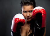 Woman with boxing gloves — Stock Photo