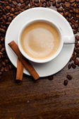 Cup of coffee with cinnamon — Stok fotoğraf