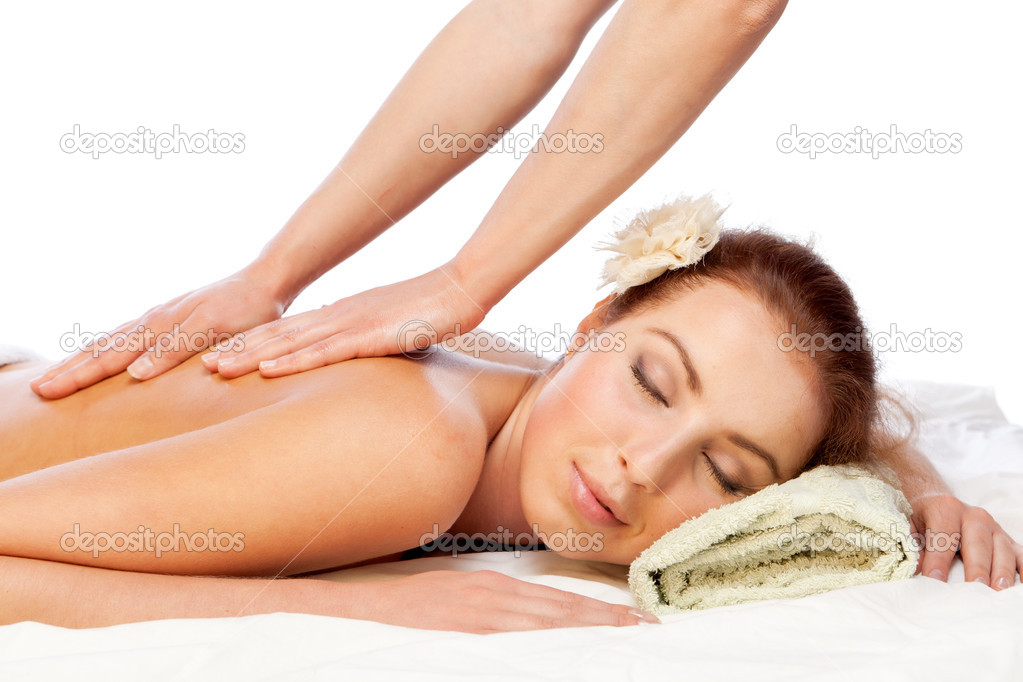 Young beautiful  woman getting massage. Isolated over white. — Stock Photo #9077049