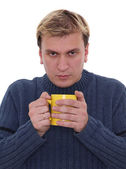 Man with cup of hot drink — Stock Photo