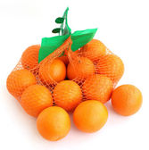 Two kilograms of oranges in the grid. — Stock Photo