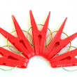 Five red pegs situated around — Stock Photo