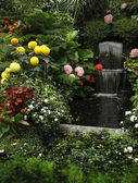 Magnificent cascade fountain in Butchard- garden — Stock Photo