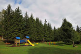 Park for children at the forest resort in the Alps — Stock Photo
