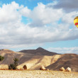 Bright balloon over soft hills — Stock Photo #8471727