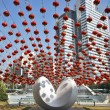 Traditional red lanterns and the modern abstract sculpture, — Stock Photo
