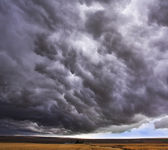 Enormous storm cloud above an field — Stock Photo