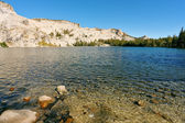 High-mountainous May lake — Stock Photo
