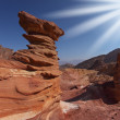 The sparkling sun above interesting natural forms of sandstone h — Stock Photo #9706500