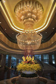 Magnificent huge luster in a lobby of hotel in China — Stock Photo