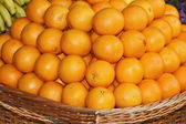Wicker basket with oranges. — Stock Photo