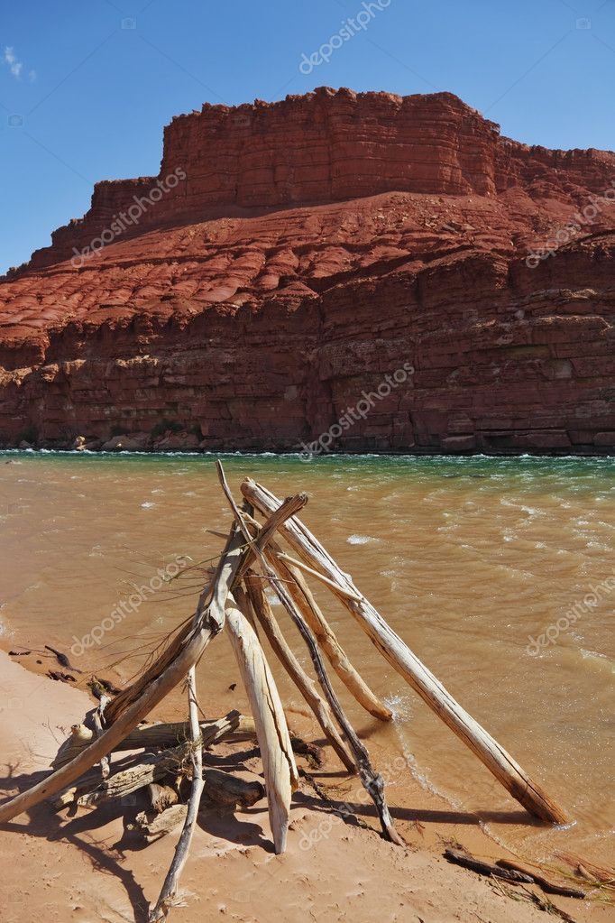 The ritual construction of the Navajo dry poles and sticks. The banks of the Colorado River. — Stock Photo #9877052