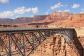 The metal bridge in abrupt coast of desert — Stock Photo