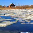 Driving of ice on river near villages — Stock Photo