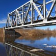 Railway bridge through small river — Stock Photo #10699533