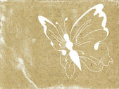 Butterfly silhouette on old paper — Stock Photo