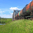 Freight train near railway bridge — Stock Photo