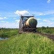 Freight train near railway bridge — Stockfoto