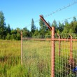 Fence on green field — Stock Photo