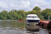Motor boat on river quay — Stock Photo