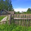 Old fence near rural wooden building — Stok Fotoğraf #9453002