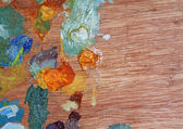 Wooden palette with oil paint — Stock Photo