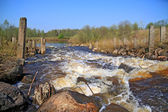 River flow on old destroyed dam — Stock Photo