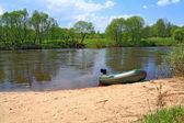 Motor boat on river coast — Stock Photo