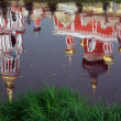 Church reflection in river water — Stock Photo