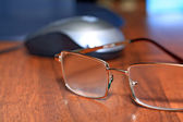 Spectacles on wooden table — Stock Photo
