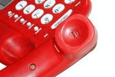 Old red telephone on white background — Stock Photo