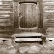 Door in old wooden house, sepia - Stok fotoğraf
