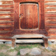 Door in old wooden house - Stock Photo