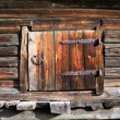 Wooden door in rural barn - Stok fotoğraf