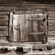 Wooden door in rural barn, sepia - Stok fotoğraf