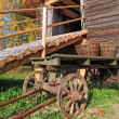 Aging cart near rural stable - Stok fotoğraf