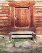 Door in old wooden house — Stock Photo