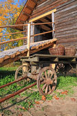 Aging cart near rural stable — Stock Photo