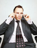 Businessman with a pair of modern glasses — Stock Photo